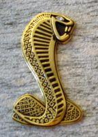 Emblem: Cobra / bronce